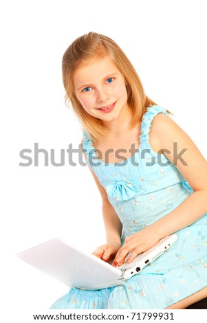 smiling eight years old girl working with computer over white