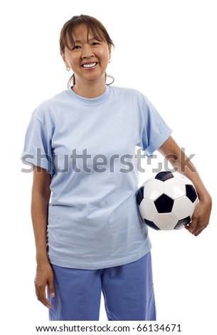 Smiling elderly Asian woman holding a soccer ball football wearing a blank light blue t-shirt, Ready for your design or logo, isolated over white background - stock photo