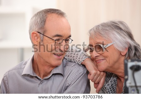 Smiling elderly couple at home