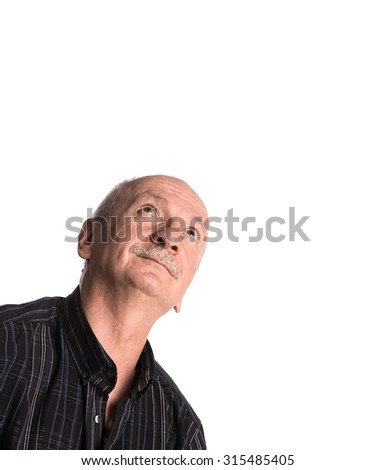 Smiling elderly man looking up on a white background with copy-space - stock photo