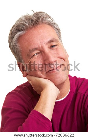 Smiling elderly man putting his hand to his chin - stock photo