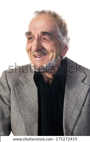 Smiling elderly man with a deeply lined face - stock photo