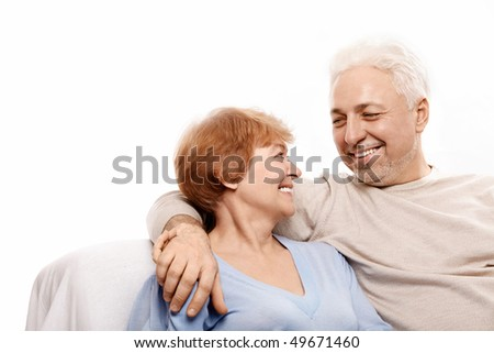 Smiling elderly pair on a white background - stock photo