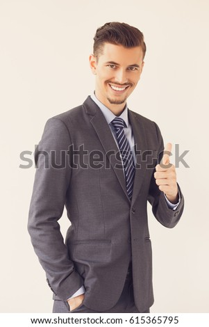 Smiling Elegant Business Leader Showing Thumb Up