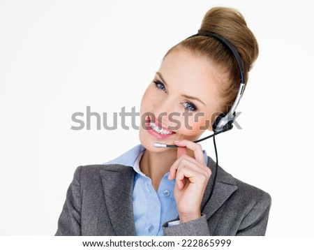 Smiling elegant businesswoman in a headset conceptual of a receptionist   private admin assistant  secretary or call center operator  on white - stock photo