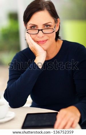 smiling elegant middle aged woman relaxing at home - stock photo