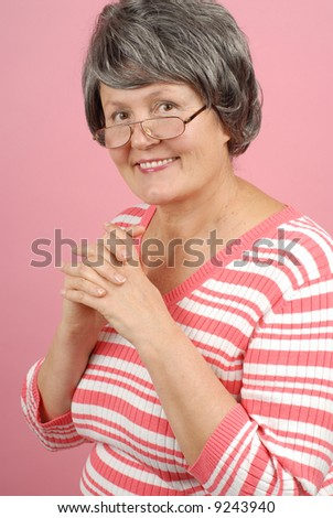 Smiling, elegant, successful older woman in her sixties - stock photo