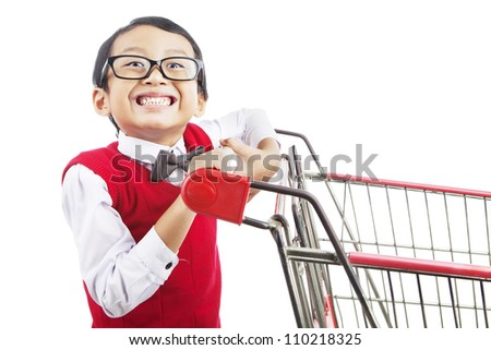 Smiling elementary school student with shopping cart. shot in studio isolated on white