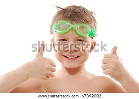 smiling elementary 5 year ols  boy with wet hair,  goggles and thumbs up over white - stock photo