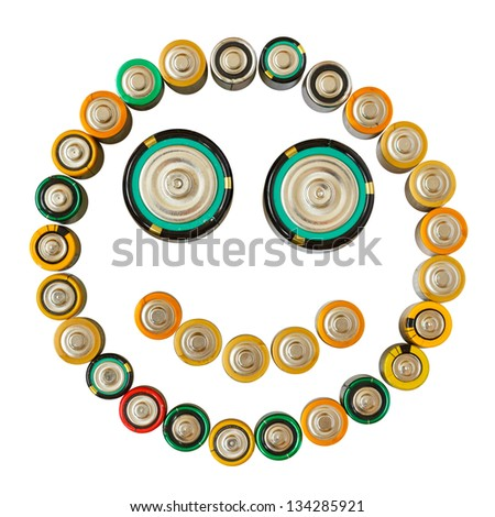 Smiling emoticon made from batteries isolated on the white background - stock photo