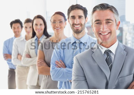Smiling employee's in a line at work - stock photo