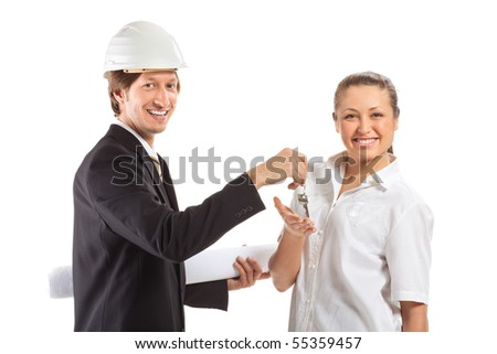smiling engineer giving keys from apartment - stock photo