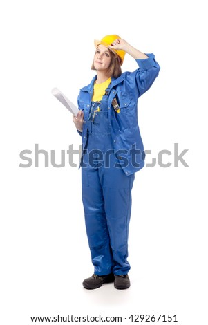smiling engineer or architect female in yellow helmet and blue workwear with blueprints looking up isolated on white background