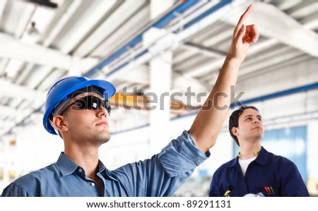 Smiling engineers at work - stock photo