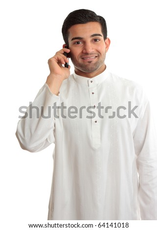 """Smiling ethnic business man using phone - in traditional ethnic robe - Kurta - fastened with ruby buttons. The name Kurta is from Urdu & Hindi, & originally Persian (literally, """"a collarless shirt""""). - stock photo"""