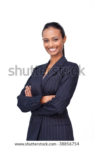 Smiling ethnic businesswoman with folded arms - stock photo