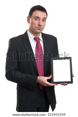Smiling executive holding a tablet with copy space on screen - stock photo