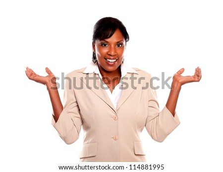 Smiling executive woman with arms up looking at you on isolated background - stock photo