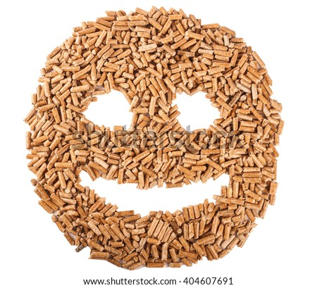 Smiling face made of biomass (wooden pellets) isolated on white - stock photo