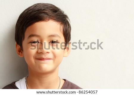 Smiling face of Asian young boy - stock photo