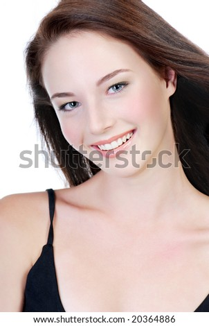 smiling face of young beautiful teen shot on white background - stock photo