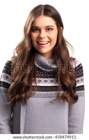 Smiling face of young lady. Gray sweater with pattern. Expression of joy. Cheerful model looks at camera. - stock photo