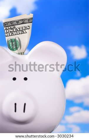 Smiling Face Piggy Bank With $100 - stock photo