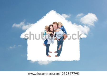 Smiling Family Against A White Background against cloudy sky - stock photo