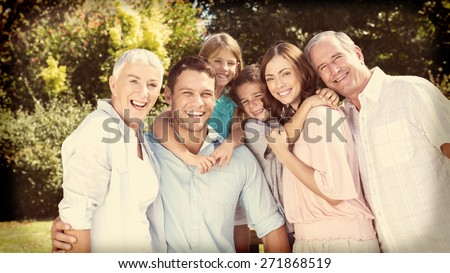 Smiling family and grandparents in the countryside looking at camera - stock photo