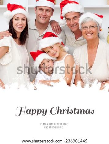 Smiling family baking Christmas cakes against happy christmas - stock photo
