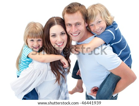 Smiling family enjoying piggyback ride against a white background