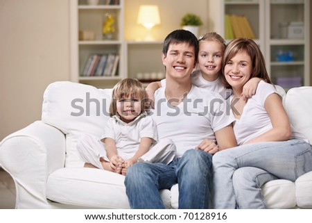 Smiling family home evening - stock photo