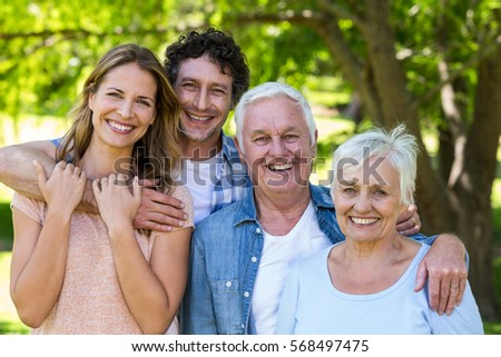 Smiling family hugging in a park