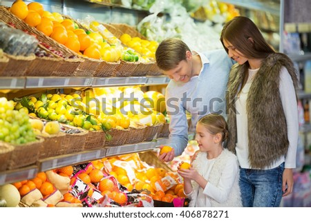 Smiling family in store - stock photo