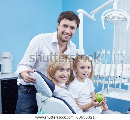 Smiling family in the dental office