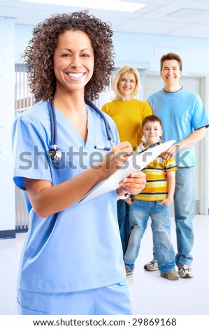 Smiling family medical doctor nurse and young family. - stock photo