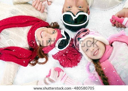 Smiling family of three people enjoying in the winter vacation