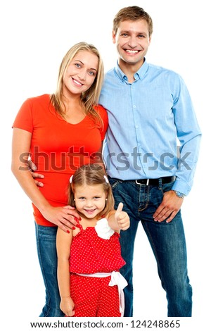 Smiling family on a white background. Cute girl gesturing thumbs up
