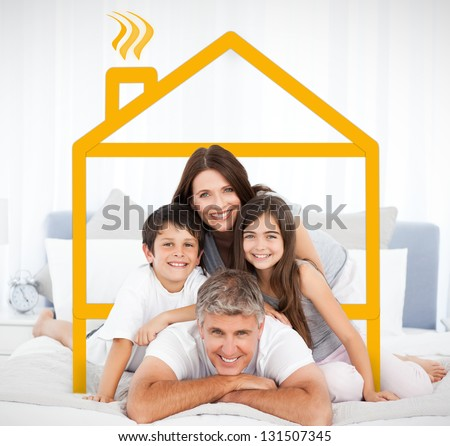 Smiling family portrait in bed framed by yellow digital house illustration - stock photo