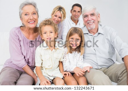 Smiling family posing for a picture on a white background