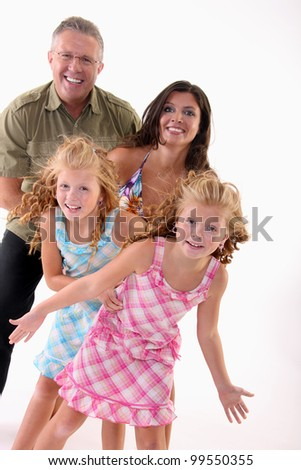 Smiling family posing on the white background - stock photo