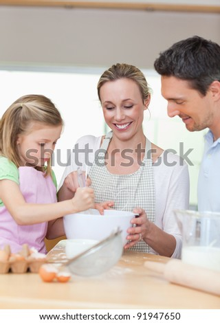 Smiling family preparing cookies together
