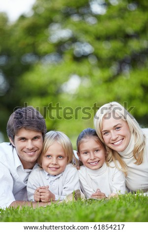 Smiling family with two children outdoors