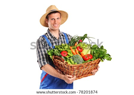 Smiling farmer holding a basket of vegetables isolated on white background