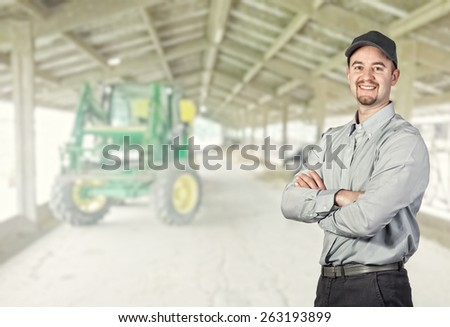 smiling farmer portrait and farm background - stock photo
