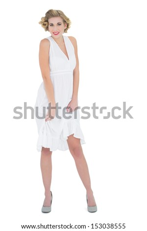 Smiling fashion blonde model looking at camera on white background - stock photo
