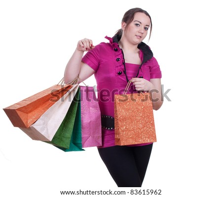 smiling fat young woman with shopping bags - stock photo