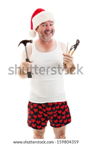 Smiling father in a Santa hat, holding his tools.  He's ready to assemble Christmas gifts.   - stock photo