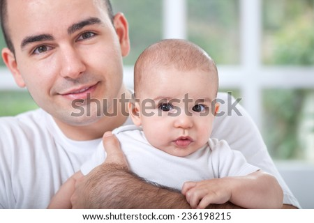 Smiling father with baby child - stock photo