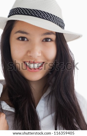 Smiling female beauty wearing a hat